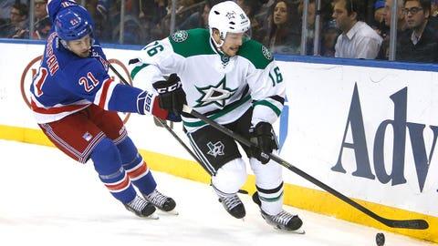 Dallas Stars' Ryan Garbutt (16) controls the puck against New York Rangers' Derek Stepan (21) during the second period of an NHL hockey game, Friday, Jan. 10, 2014, in New York. New York won 3-2. (AP Photo/Jason DeCrow)