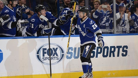 Jan 18, 2014; Tampa, FL, USA; Tampa Bay Lightning right wing Martin St. Louis (26) celebrates with his teammates after scoring his third goal of the first period against the San Jose Sharks at Tampa Bay Times Forum. Mandatory Credit: Jonathan Dyer-USA TODAY Sports