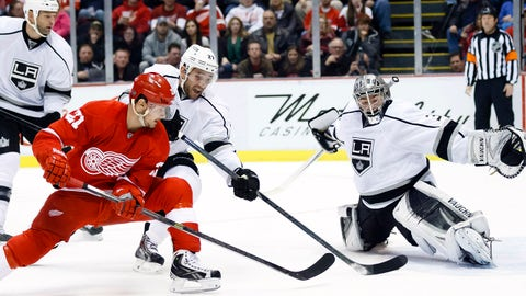 Jan 18, 2014; Detroit, MI, USA; Detroit Red Wings left wing Tomas Tatar (21) tries to score on Los Angeles Kings goalie Jonathan Quick (32) defended by defenseman Alec Martinez (27) in the third period at Joe Louis Arena. Detroit won 3-2 in a shoot-out. Mandatory Credit: Rick Osentoski-USA TODAY Sports