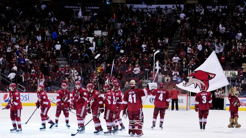 Jan 18, 2014; Glendale, AZ, USA; The Phoenix Coyotes salute fans after beating the New Jersey Devils 3-2 at Jobing.com Arena. Mandatory Credit: Matt Kartozian-USA TODAY Sports