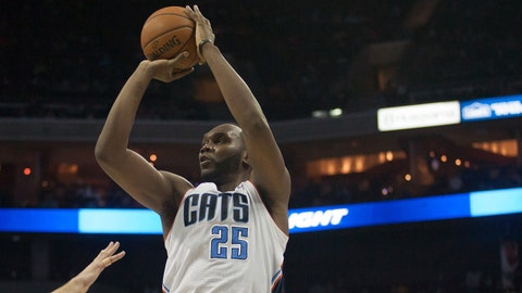 Jan 20, 2014; Charlotte, NC, USA; Charlotte Bobcats center Al Jefferson (25) shoots the ball over Toronto Raptors center Jonas Valanciunas (17) during the second half at Time Warner Cable Arena. The Bobcats defeated the Raptors 100-95. Mandatory Credit: Jeremy Brevard-USA TODAY Sports
