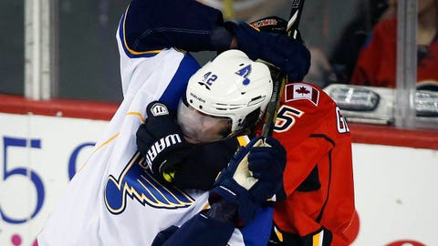 St. Louis Blues' David Backes, left, is grabbed in a chokehold by Calgary Flames' Mark Giordano during first-period NHL hockey game action against the Calgary Flames in Calgary, Alberta, Thursday, Jan. 9, 2014. (AP Photo/The Canadian Press, Jeff McIntosh)