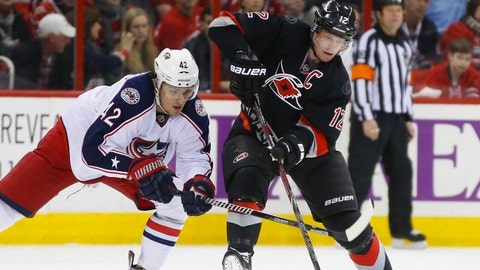 Jan 27, 2014; Raleigh, NC, USA; Carolina Hurricanes forward Eric Staal (12) carries the puck in front of the Columbus Blue Jackets forward Artem Anisimov (42) during the 3rd period at PNC Arena. The Carolina Hurricanes defeated Columbus Blue Jackets 3-2. Mandatory Credit: James Guillory-USA TODAY Sports