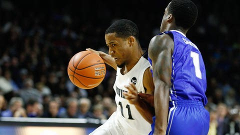 Jan 18, 2014; Providence, RI, USA; Providence Friars guard Bryce Cotton (11) drives to the hoop against Creighton Bluejays guard Austin Chatman (1) during the first half at Dunkin Donuts Center. Mandatory Credit: Mark L. Baer-USA TODAY Sports