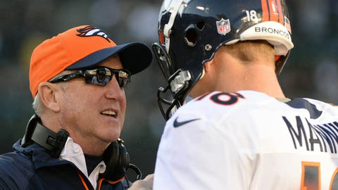 December 29, 2013; Oakland, CA, USA; Denver Broncos head coach John Fox (left) talks to quarterback Peyton Manning (18) during the fourth quarter against the Oakland Raiders at O.co Coliseum. The Broncos defeated the Raiders 34-14. Mandatory Credit: Kyle Terada-USA TODAY Sports