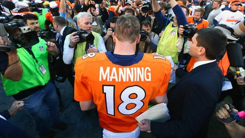 January 19, 2014; Denver, CO, USA; Denver Broncos quarterback Peyton Manning (18) following the 26-16 victory against the New England Patriots following the 2013 AFC Championship football game at Sports Authority Field at Mile High. Mandatory Credit: Mark J. Rebilas-USA TODAY Sports