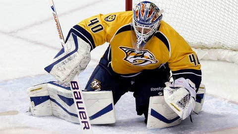Nashville Predators goalie Devan Dubnyk (40) makes a stop against the Colorado Avalanche in the second period of an NHL hockey game Saturday, Jan. 18, 2014, in Nashville, Tenn. The game is Dubnyk's first in goal for the Predators since being acquired from the Edmonton Oilers. (AP Photo/Mark Humphrey)