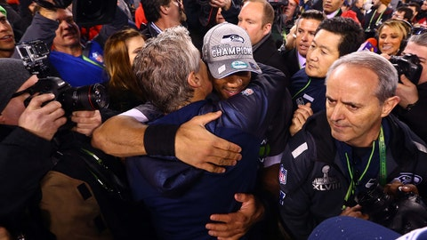 Feb 2, 2014; East Rutherford, NJ, USA; Seattle Seahawks head coach Pete Carroll (left) celebrates with quarterback Russell Wilson after Super Bowl XLVIII against the Denver Broncos at MetLife Stadium.  Mandatory Credit: Mark J. Rebilas-USA TODAY Sports