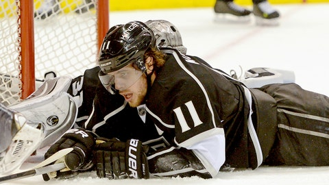 Feb 1, 2014; Los Angeles, CA, USA;  Los Angeles Kings goalie Jonathan Quick (32) and center Anze Kopitar (11) lay on the ice after Philadelphia Flyers center Claude Giroux (not pictured) scored in the third period of game at Staples Center. Philadelphia Flyers won 2-0. Mandatory Credit: Jayne Kamin-Oncea-USA TODAY Sports