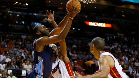Mar 3, 2014; Miami, FL, USA; Charlotte Bobcats center Al Jefferson (25) grabs a rebound as Miami Heat center Chris Bosh (1) defends in the first half at American Airlines Arena. Mandatory Credit: Robert Mayer-USA TODAY Sports