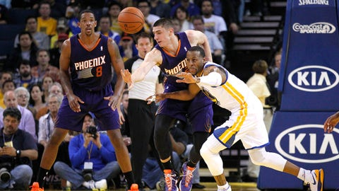 Mar 9, 2014; Oakland, CA, USA; Golden State Warriors forward Andre Iguodala (9) Phoenix Suns center Alex Len (21) fight for control of a loose ball in the first quarter at Oracle Arena. Mandatory Credit: Cary Edmondson-USA TODAY Sports