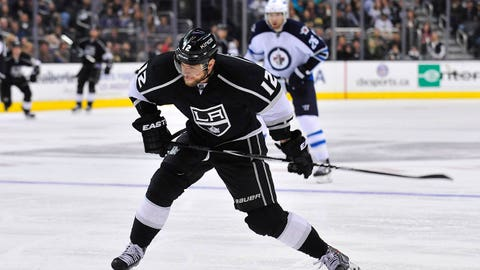 March 29, 2014; Los Angeles, CA, USA; Los Angeles Kings right wing Marian Gaborik (12) shoots on goal against the Winnipeg Jets during the third period at Staples Center. Mandatory Credit: Gary A. Vasquez-USA TODAY Sports