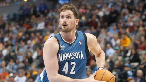 Mar 3, 2014; Denver, CO, USA; Minnesota Timberwolves forward Kevin Love (42) drives to the basket during the second half against the Denver Nuggets at Pepsi Center.  The Timberwolves won 132-128.  Mandatory Credit: Chris Humphreys-USA TODAY Sports