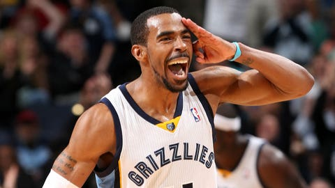 MEMPHIS, TN - MARCH 1: Mike Conley #11 of the Memphis Grizzlies celebrates during a game against the Cleveland Cavaliers on March 1, 2014 at FedExForum in Memphis, Tennessee. NOTE TO USER: User expressly acknowledges and agrees that, by downloading and or using this photograph, User is consenting to the terms and conditions of the Getty Images License Agreement. Mandatory Copyright Notice: Copyright 2014 NBAE (Photo by Joe Murphy/NBAE via Getty Images)