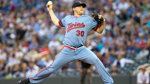 Jun 5, 2014; Minneapolis, MN, USA; Minnesota Twins starting pitcher Kevin Correia (30) pitches in the first inning against the Milwaukee Brewers at Target Field. Mandatory Credit: Brad Rempel-USA TODAY Sports