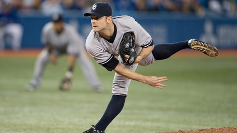 Apr 6, 2014; Toronto, Ontario, CAN; New York Yankees relief pitcher David Robertson (30) throws a pitch in the ninth inning during a game against the Toronto Blue Jays at the Rogers Centre. The New York Yankees won 6-4.  Mandatory Credit: Nick Turchiaro-USA TODAY Sports