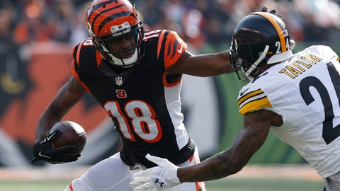 Dec 7, 2014; Cincinnati, OH, USA; Cincinnati Bengals wide receiver A.J. Green (18) stiff arms Pittsburgh Steelers cornerback Ike Taylor (24) at Paul Brown Stadium. The Steelers won 42-21. Mandatory Credit: Aaron Doster-USA TODAY Sports