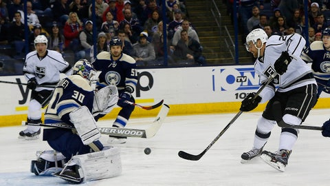 Feb 9, 2015; Columbus, OH, USA; Los Angeles Kings center Trevor Lewis (22) shoots against Columbus Blue Jackets goalie Curtis McElhinney (30) during the first period at Nationwide Arena. Mandatory Credit: Russell LaBounty-USA TODAY Sports