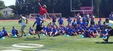Odell Beckham Jr. makes awesome one-haned grab over a kid at camp
