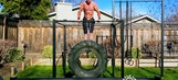 This guy is doing dips with a monster truck tire