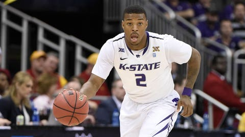 KANSAS CITY, MO - MARCH 11: Marcus Foster #2 of the Kansas State Wildcats controls the ball against the TCU Horned Frogs during the first round of the Big 12 basketball tournament at Sprint Center on March 11, 2015 in Kansas City, Missouri. (Photo by Ed Zurga/Getty Images)