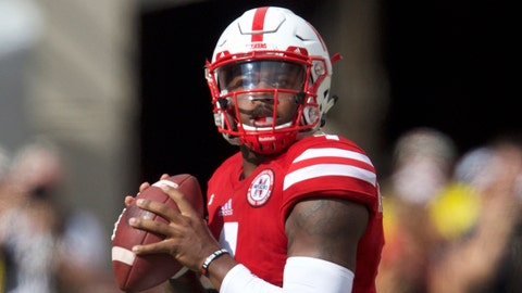 Oct 1, 2016; Lincoln, NE, USA;  Nebraska Cornhuskers quarterback Tommy Armstrong Jr (4) looks to throw against the Illinois Fighting Illini in the first quarter at Memorial Stadium. Mandatory Credit: Bruce Thorson-USA TODAY Sports