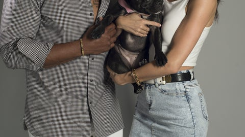 Former defensive end Larry English and a French Bulldog
