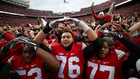 College Football: Ohio State Davon Hamilton (53), Branden Bowen (76) and Michael Hill (77) victorious on field with students and fans after winning game vs Michigan in double overtime at Ohio Stadium.