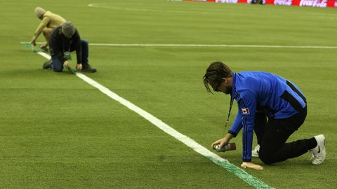 MONTREAL, PQ- NOVEMBER 22  - Impact grounds crew race to paint over lines as they installed the box to FIFA dimensions rather than MLS. Toronto FC plays the Montreal Impact in the MLS Conference Finals in the MLS Cup Playoffs  at Montreal 1976 Olympic Stadium in Montreal. November 22, 2016.        (Steve Russell/Toronto Star via Getty Images)