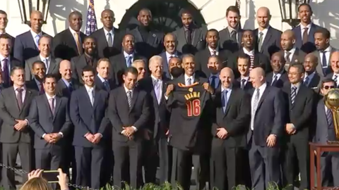 """The team presented Obama with a """"16"""" jersey"""