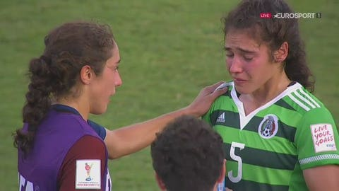 Team USA's Sabrina Flores consoles her sister after the United States beats Mexico