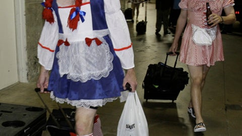 FILE - This Sept. 24, 2008 file photo shows Oakland Athletics rookie pitcher Brad Ziegler, left, heading to board the team bus after their 14-4 loss to the Texas Rangers in baseball game in Arlington, Texas. That hazing ritual of dressing up rookies as Wonder Woman, Hooters Girls and Dallas Cowboys cheerleaders is now banned. Major League Baseball created an Anti-Hazing and Anti-Bullying Policy that covers the practice. As part of the sport's new labor deal, set to be ratified by both sides Tuesday, Dec. 12, 2016 the players' union agreed not to contest it. (AP Photo/LM Otero)