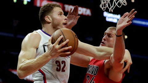 LA Clippers forward Blake Griffin, left, shoots around Portland Trail Blazers' Mason Plumlee during the first half of an NBA basketball game in Los Angeles, Monday, Dec. 12, 2016. (AP Photo/Chris Carlson)