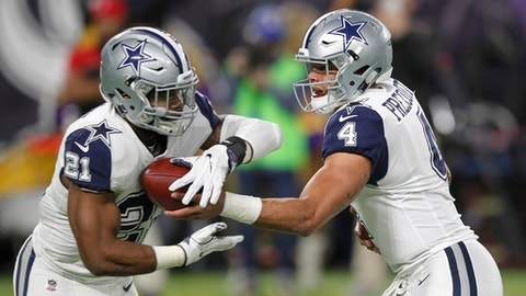 FILE - In this Thursday, Dec. 1, 2016 file photo,  Dallas Cowboys quarterback Dak Prescott, right, hands the ball off to running back Ezekiel Elliott during the first half of an NFL football game against the Minnesota Vikings in Minneapolis. The Dallas Cowboys, with rookie sensations Dak Prescott and Ezekiel Elliott, were the hottest team in the NFL before their 11-game winning streak ended last week. Now they're playing one of the hottest teams in the Tampa Bay Buccaneers, whose five-game streak is the club's longest since the Super Bowl-winning season of 2002  The Buccaneers play the Cowboys on Sunday, Dec. 18, 2016. (AP Photo/Andy Clayton-King, File)