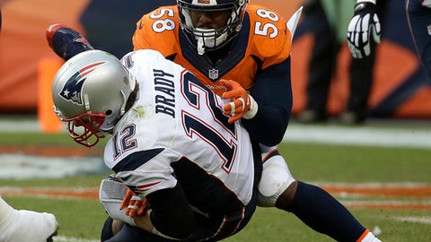 FILE - In this Sunday, Jan. 24, 2016 file photo, New England Patriots quarterback Tom Brady is sacked by Denver Broncos outside linebacker Von Miller during the second half of the NFL football AFC Championship game between the Denver Broncos and the New England Patriots in Denver. The last time Tom Brady visited Denver, the Broncos put a beating on him like he'd never had, hitting him 23 times and forcing him into 29 incompletions, two fourth-down flops and two interceptions. The man at the center of this mayhem was Von Miller. The Patriots play the Broncos on Sunday, Dec. 18, 2016. (AP Photo/Chris Carlson, File)