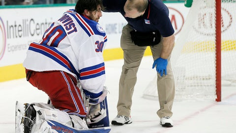 A trainer, right, checks on New York Rangers goalie Henrik Lundqvist (30) after a hit by Dallas Stars forward Cody Eakin during the first period of an NHL hockey game, Thursday, Dec. 15, 2016, in Dallas. (AP Photo/Brandon Wade)