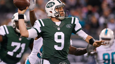 New York Jets quarterback Bryce Petty (9) throws under pressure during the second quarter of an NFL football game against the Miami Dolphins, Saturday, Dec. 17, 2016, in East Rutherford, N.J. (AP Photo/Adam Hunger)