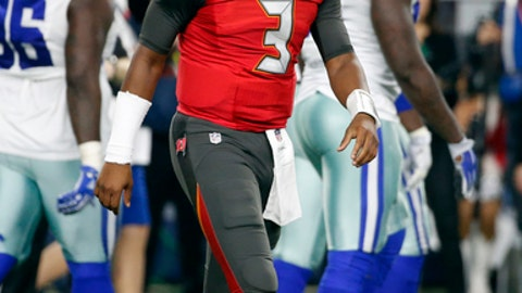 Tampa Bay Buccaneers' Jameis Winston (3) walks off the field after throwing an interception in the second half of an NFL football game against the Dallas Cowboys on Sunday, Dec. 18, 2016, in Arlington, Texas. (AP Photo/Michael Ainsworth)