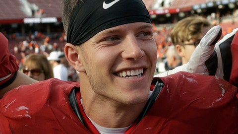 """FILE - In this Nov. 5, 2016, file photo, Stanford running back Christian McCaffrey (5) smiles after Stanford defeated Oregon State, 26-15, in an NCAA college football game, in Stanford, Calif. McCaffrey is done playing college football. Stanford's star running back announced on Twitter on Monday, Dec. 19, 2016, that he will not play in the 16th-ranked Cardinal's Sun Bowl game against North Carolina (8-4) on Dec. 30 in El Paso, Texas. """"Very tough decision, but I have decided not to play in the Sun Bowl so I can begin my draft prep immediately,"""" McCaffrey said. (AP Photo/Marcio Jose Sanchez, File)"""