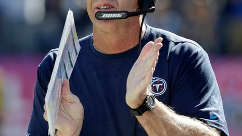 FILE - In this Oct. 23, 2016, file photo, Tennessee Titans head coach Mike Mularkey applauds a play in the first half of an NFL football game against the Indianapolis Colts in Nashville, Tenn. His confidence has filtered through the Titans who are poised to go from the worst in the NFL a year ago to first in the AFC South with two games left. They visit Jacksonville on Saturday. (AP Photo/James Kenney, File)