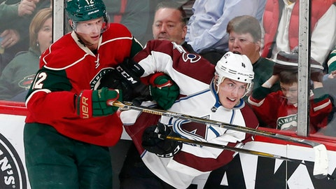 Colorado Avalanche's Tyson Barrie, right, tries to break free from Minnesota Wild's Eric Staal along the boards during the second period of an NHL hockey game Tuesday, Dec. 20, 2016, in St. Paul, Minn. (AP Photo/Jim Mone)