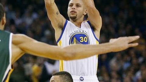 Golden State Warriors guard Stephen Curry (30) shoots over Utah Jazz guard Dante Exum (11) during the first half of an NBA basketball game Tuesday, Dec. 20, 2016, in Oakland, Calif. (AP Photo/Tony Avelar)