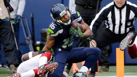 Seattle Seahawks' Tyler Lockett, right, tumbles to the turf and injures his right left as Arizona Cardinals' Brandon Williams tackles him in the first half of an NFL football game, Saturday, Dec. 24, 2016, in Seattle. (AP Photo/Ted S. Warren)