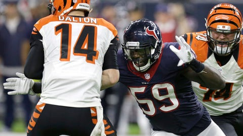 Cincinnati Bengals quarterback Andy Dalton (14) is sacked by Houston Texans' Whitney Mercilus (59) during the second half of an NFL football game Saturday, Dec. 24, 2016, in Houston. (AP Photo/Sam Craft)