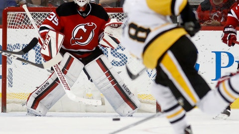 Pittsburgh Penguins defenseman Brian Dumoulin (8) takes a shot on New Jersey Devils goalie Cory Schneider during the second period of an NHL hockey game, Tuesday, Dec. 27, 2016, in Newark, N.J. (AP Photo/Julio Cortez)