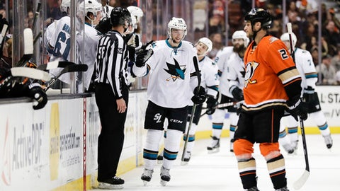 San Jose Sharks' Melker Karlsson, center, of Sweden, celebrates his goal as Anaheim Ducks' Kevin Bieksa, foreground, skates nearby during the second period of an NHL hockey game Tuesday, Dec. 27, 2016, in Anaheim, Calif. (AP Photo/Jae C. Hong)