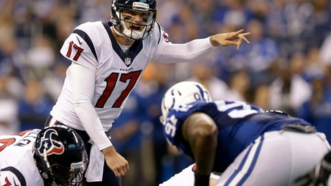 FILE - In a Sunday, Dec. 11, 2016 file photo, Houston Texans quarterback Brock Osweiler yells on the line of scrimmage during the first half of an NFL football game against the Indianapolis Colts, in Indianapolis. Among the worst calls of the 2016 NFL season was the Houston Texans deciding to break the bank for Osweiler. Osweiler is a backup heading into the playoffs just like last year, when he was supplanted by Peyton Manning in Denver.  (AP Photo/Michael Conroy, File)