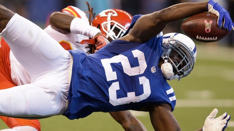 FILE - In this Oct. 30, 2016, file photo, Indianapolis Colts' Frank Gore (23) dives for a 18-yard touchdown reception against Kansas City Chiefs' Ron Parker during the first half of an NFL football game, in Indianapolis. Thirty three-year-old running back Gore needs 36 yards to become Indy's first 1,000-yard runner since 2007, and the oldest in the league since John Riggins achieved the feat in 1984 when he was 35. (AP Photo/Michael Conroy, File)