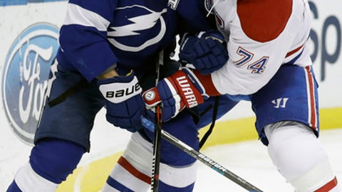 Tampa Bay Lightning left wing Ondrej Palat (18), of the Czech Republic, and Montreal Canadiens defenseman Alexei Emelin (74), of Russia, battle for the puck during the second period of an NHL hockey game Wednesday, Dec. 28, 2016, in Tampa, Fla. (AP Photo/Chris O'Meara)
