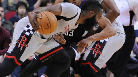 Houston Rockets guard James Harden, front, works the ball against Los Angeles Clippers forward Wesley Johnson (33) during the first half of an NBA basketball game Friday, Dec. 30, 2016, in Houston. (AP Photo/George Bridges)